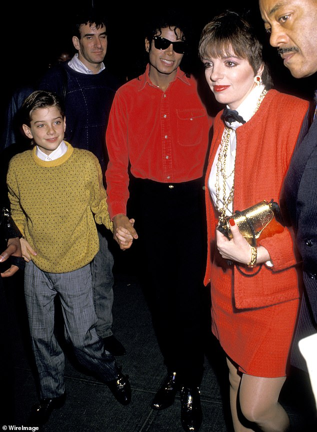 MJ holding hands